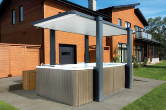 The Covana Legend swim spa cover easily raises and tilts to provide shade and protection from weather.